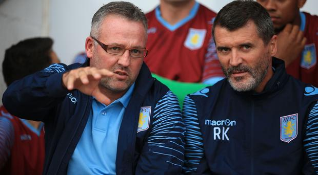 Paul Lambert, left, says there was no rift with former assistant Roy Keane, right