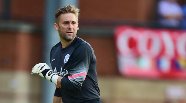 QPR goalkeeper Rob Green says the pressure is on them to pick up points at home after failing to collect a single away point all season