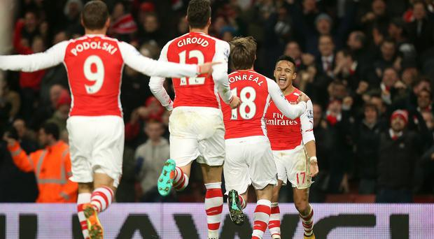 Alexis Sanchez, right, was the hero for Arsenal again