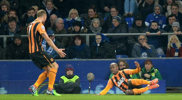 Hull City's Sone Aluko (right) celebrates scoring his side's first goal of the game with teammate David Meyler (left) during the Barclays Premier League match at Goodison Park, Liverpool.