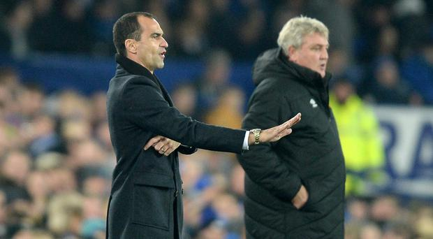 Steve Bruce's, right, Hull took a point from Everton to move out of the relegation zone