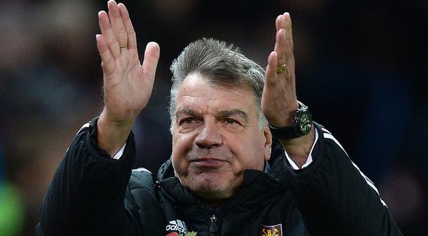 West Ham United manager Sam Allardyce salutes the fans after his teams 2-2 draw against Stoke City, during the Barclays Premier League match at the Britannia Stadium, Stoke.