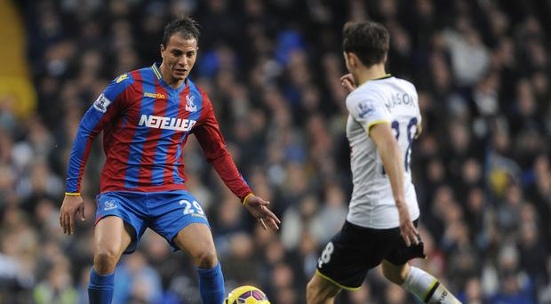 Crystal Palace's Marouane Chamakh, left, and Tottenham's Ryan Mason compete for the ball