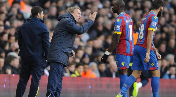 Neil Warnock, left, was delighted with his side's performance at Spurs