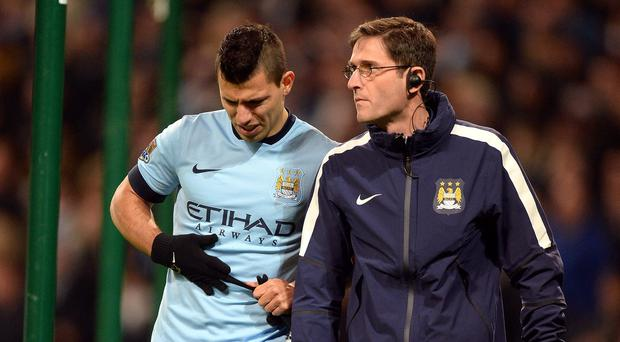 Sergio Aguero is set to miss Manchester City's vital Champions League trip to Roma