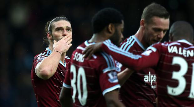 Andy Carroll, pictured left, scored twice to help West Ham beat Swansea on Sunday