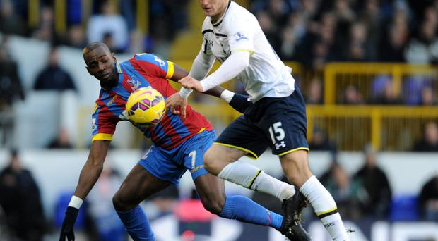 Tight contest: Crystal Palace star Yannick Bolasie tussles with Eric Dier of Tottenham at the weekend
