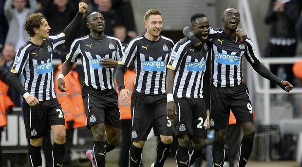 Newcastle match-winner Papiss Cisse, right, knows he is not guaranteed a place in Alan Pardew's starting XI