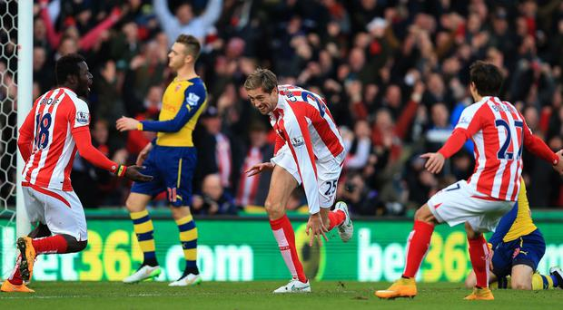 Stoke's Peter Crouch celebrates scoring the first goal after only 19 seconds in their 3-2 victory over Arsenal