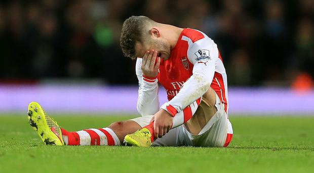 Jack Wilshere suffered the ankle injury against Manchester United in November