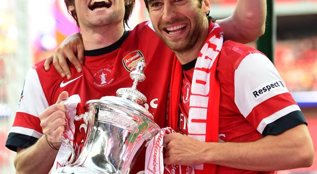 Tomas Rosicky (L) and Mathieu Flamini of Arsenal celebrate victory with the trophy after the FA Cup final