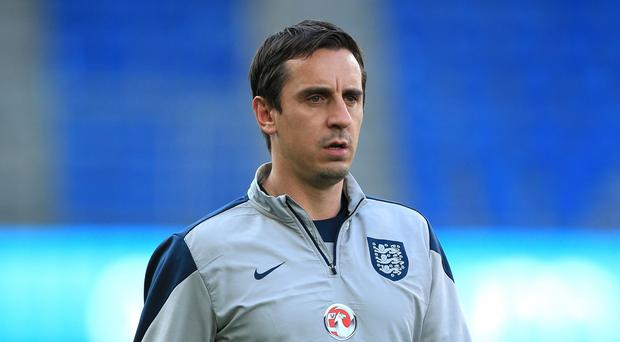 Neville is employed by Sky and is also part of England's coaching set-up