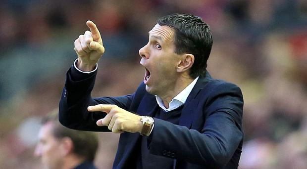 Sunderland manager Gus Poyet, pictured, admits it will be difficult to attract top-quality players in the January transfer window