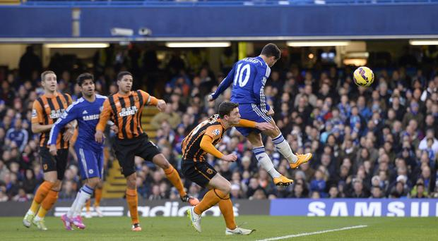 Eden Hazard, right, heads in Chelsea's first goal against Hull City