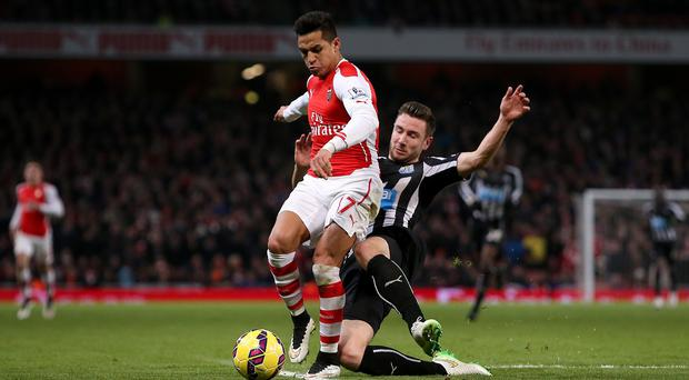 Arsenal returned to winning ways in the Barclays Premier League with a 4-1 victory over Newcastle