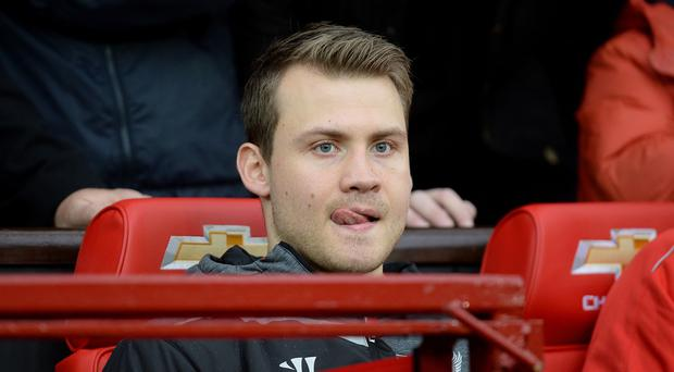Liverpool goalkeeper Simon Mignolet, pictured, has been dropped by manager Brendan Rodgers