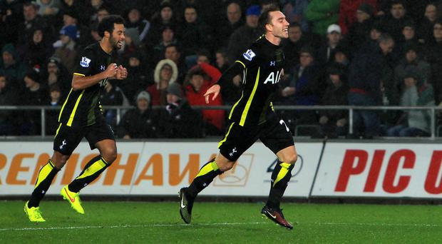 Christian Eriksen celebrates another late winner for Spurs on their travels