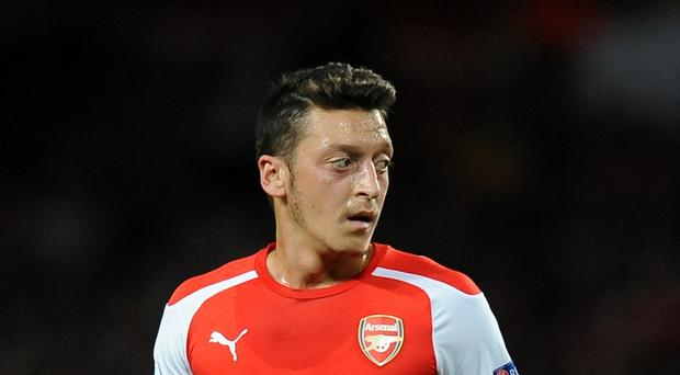 Arsenal midfielder Mesut Ozil is hopeful of returning soon from a knee injury.