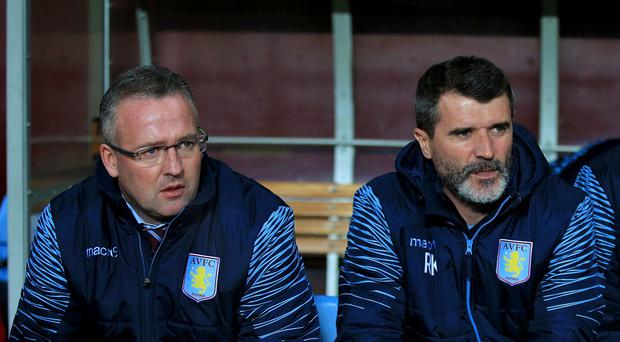 Aston Villa boss Paul Lambert, left, feels his ex-assistant Roy Keane, right, deserves 'a break'