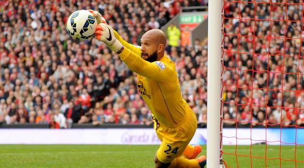 Everton goalkeeper Tim Howard, pictured, has sympathy for axed Liverpool counterpart Simon Mignolet
