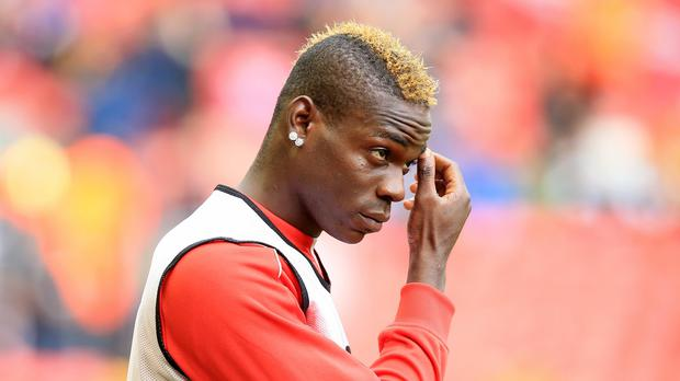 Liverpool striker Mario Balotelli set to be named Player of the Year thanks to cheeky Manchester United and Arsenal fans
