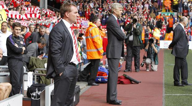 Liverpool manager Brendan Rodgers, left, has the sympathy of Arsenal manager Arsene Wenger, right