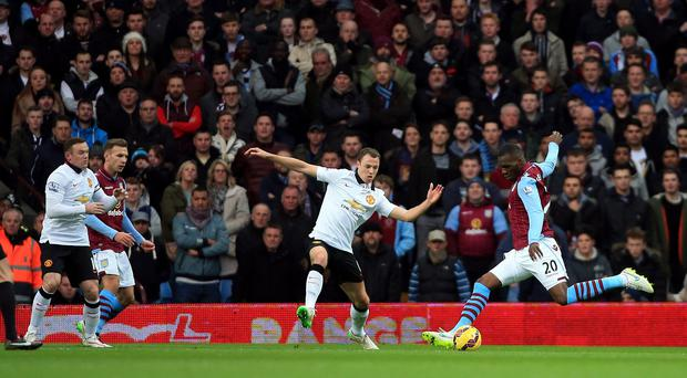 Christian Benteke, right, scores the opening goal for Aston Villa against Manchester United