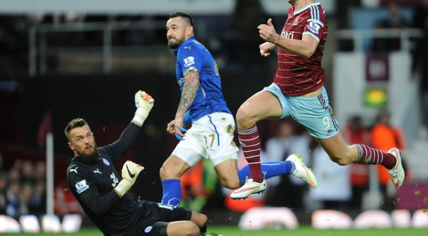 Flying high: West Ham's Andy Carroll scores against Leicester