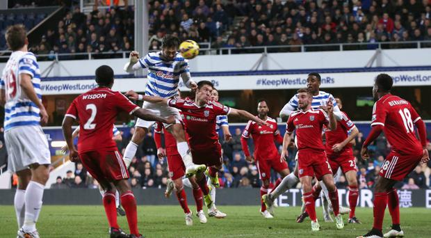 Head boy: Charlie Austin powers home the winner for Queen's Park Rangers against West Brom on Saturday