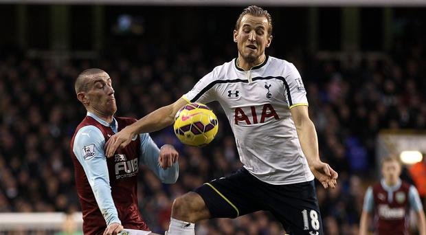 Harry Kane, right, believes he can become the 20-goal-a-season striker that Tottenham crave