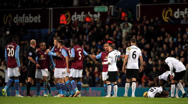 Aston Villa protest after Gabby Agbonlahor, centre, was sent off for a foul on Ashley Young in Saturday's 1-1 draw with Manchester United