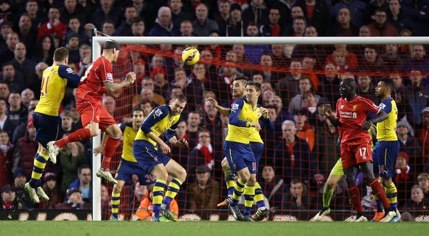 Martin Skrtel, second left, powered in Liverpool's late equaliser despite a nasty head injury