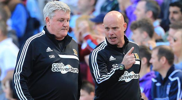 Hull manager Steve Bruce, left, has lost assistant Steve Agnew, right, to Middlesbrough