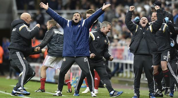 Head coach Gus Poyet and the Sunderland bench show their delight at Sunday's late winner against Newcastle