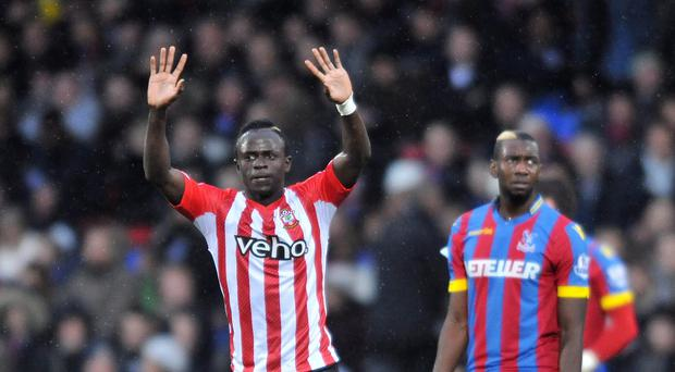 Southampton's Saido Mane, left, celebrates the first goal against Crystal Palace