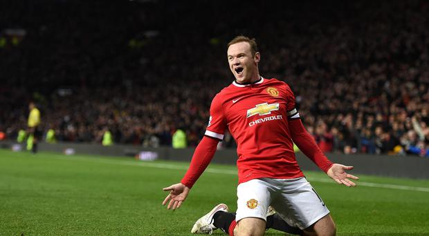 Manchester United's Wayne Rooney celebrates his second against Newcastle