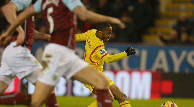 Liverpool's Raheem Sterling, right, scores the only goal against Burnley