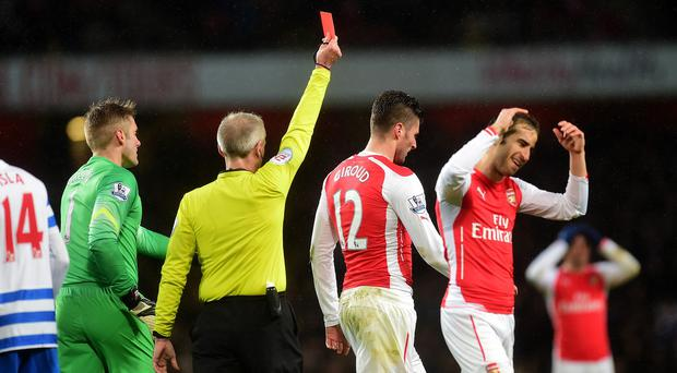 Arsenal's Olivier Giroud, centre, is given his marching orders against QPR