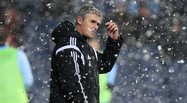 West Brom manager Alan Irvine watched his side lose again