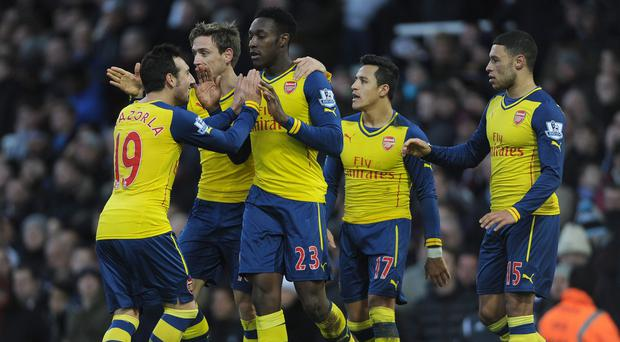Danny Welbeck, centre, netted in Arsenal's win