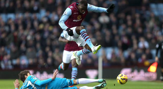 Sunderland's Santiago Vergini, left, and Aston Villa's Christian Benteke battle for the ball