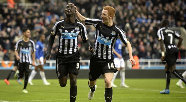 Papiss Cisse, left, and Jack Colback, right, both scored for Newcastle
