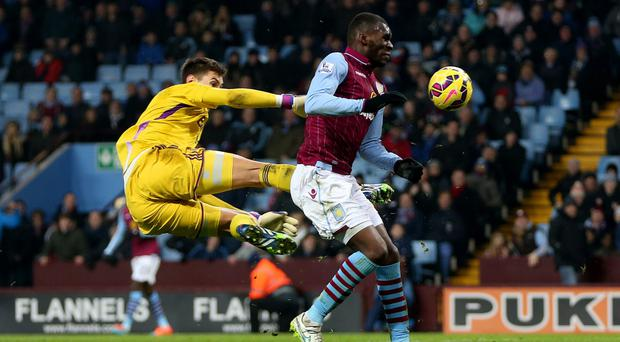 Not mellow yellow: Benteke is challenged by Pantimilion