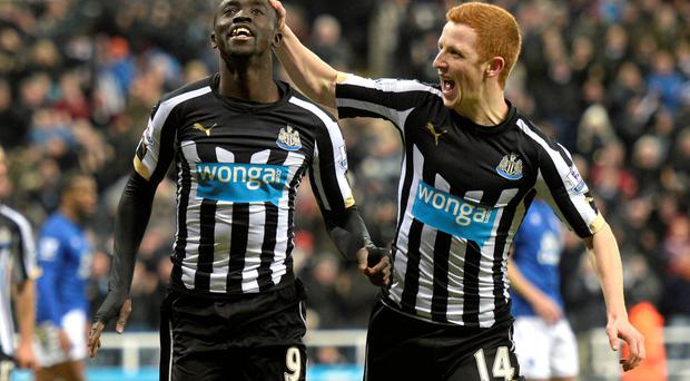 Home comforts: Papiss Cisse marks his goal with Jack Colback