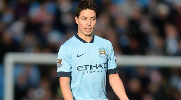 Samir Nasri is convinced Manchester City will mount a strong defence of their title
