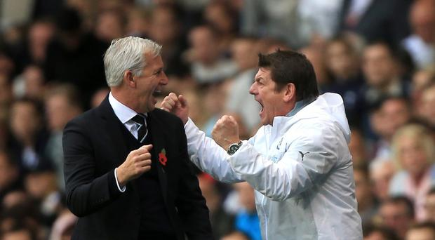 John Carver, right, could become Newcastle boss on a long-term basis after Alan Pardew's, left, departure