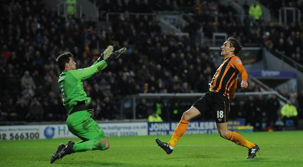 Hull City's Nikica Jelavic, right, scores the second goal against Everton