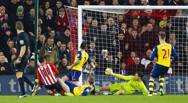 Southampton's Dusan Tadic, left, turns home the second goal