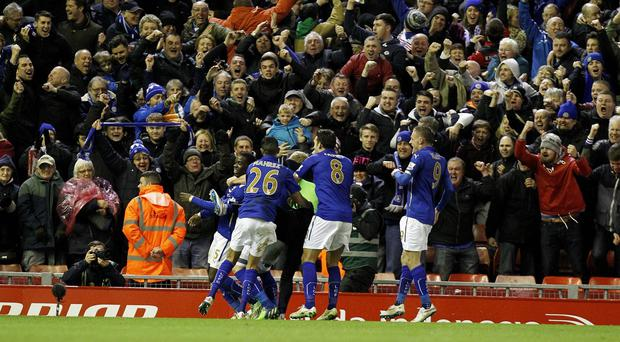 Jeffrey Schlupp, left, equalised for Leicester