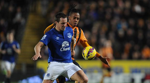 Phil Jagielka, front, has called for Everton's players to take the pressure off manager Roberto Martinez